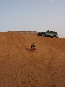 A boy, a truck and the dunes of Dubai