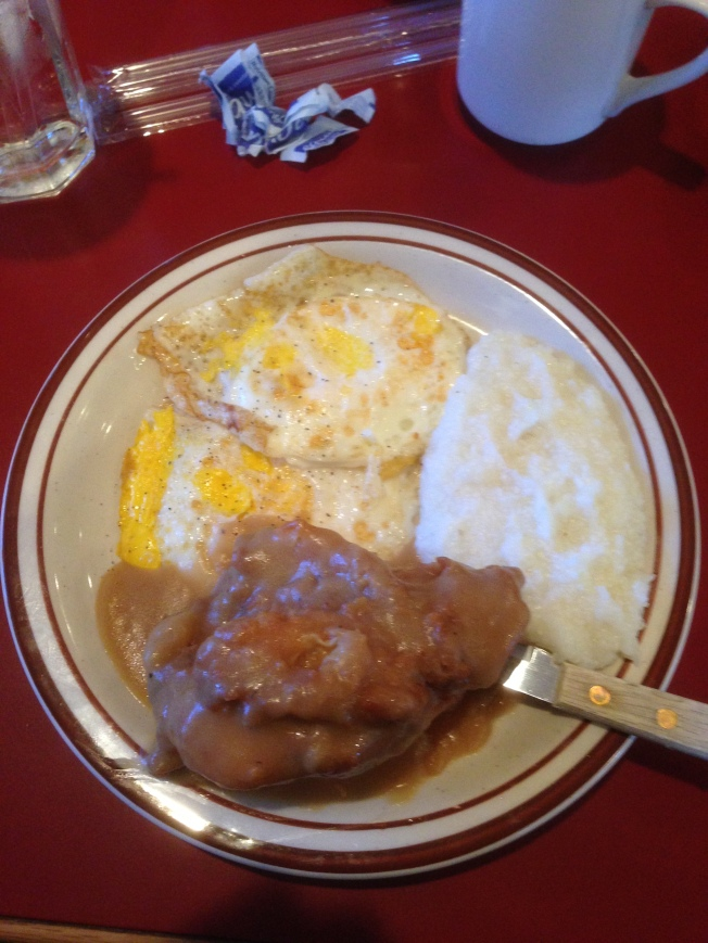 The husband's brekkie at Mama Dips...Chicken & gravy, eggs, grits and biscuits
